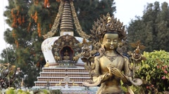 The statue and the stupa at the Kopan monastery Stock Footage