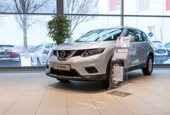 Inside in the office of official dealer Nissan. .New Nissan X-Trail - stock photo