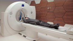 Modern MRI machine examines adult male patient Stock Footage