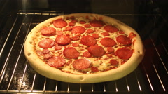 Time-Lapse of Pizza baking in the oven Stock Footage