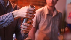 Barmen with shaker  pouring cocktail into glass Stock Footage