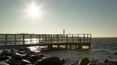 Tourist with backpack looking at the cold Baltic sea in winter time Stock Footage