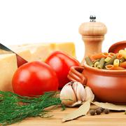 Vegetables, pasta, spices and kitchen utensils Stock Photos