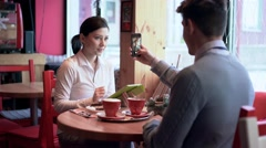 Two people in cafe taking selfie Stock Footage