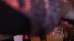 Barmen hand with shaker pouring cocktail Stock Footage