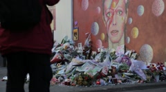 Man Standing Observing David Bowie Memorial Stock Footage