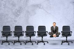 Businessman in lotus posture Stock Photos