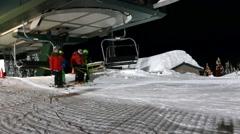 Alpine Skiing Resort - 41- Night, Lift, People - Fast Motion Stock Footage