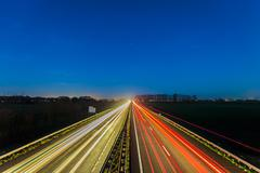 Highway between the Dutch cities of Arnhem and Doesburg - stock photo