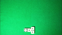 Stop motion of domino game on green cloth background Stock Footage