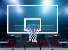 Glass basketball board and hoop in an arena - stock photo