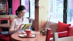 A woman with tablet waiting for friend Stock Footage