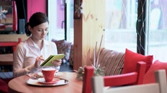 A woman in cafe using internet Stock Footage