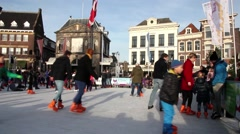 People ice skating in the Christmas market in Gouda, The Netherlands - stock footage