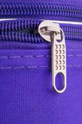 Pull Tab and Chain of a Zipper on a Violet Suitcase Stock Photos