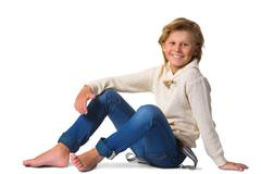 Cute blonde boy or teenager in full length casual style blue jeans posing - stock photo