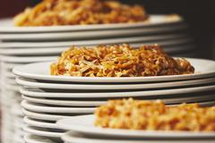 White plates with dinner stacked together - selective focus - stock photo