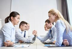 Stock Photo of smiling business people having conflict in office