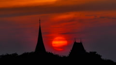 Buddhist temple at sunset in Thailand Stock Video - stock footage