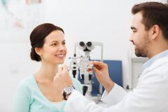 Stock Photo of optician with trial frame and patient at clinic