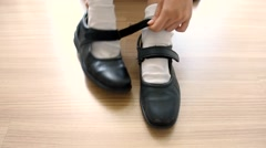Asian Thai schoolgirl student in high school uniform wearing black leather shoes Stock Footage