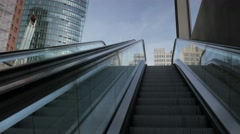 POV shot coming up an escalator into Potsdamer Platz in Berlin Stock Footage