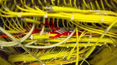 Data Center Servers With Yellow Cable Upload And Download Server  - Tilt Up Stock Footage