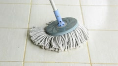Cloth mop clean a white tile floor as housekeeping housework tool for housewife Stock Footage