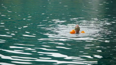 Girl swimming in the lake. Stock Footage