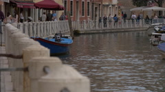 Boats on Rio dei Tolentini and people on Fondamenta dei Tolentini in Venice Stock Footage