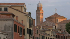 View of the tower of a church and colorful buildings in sunlight in Venice - stock footage