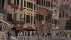People walking on Fondamenta dei Tolentini in Venice Stock Footage