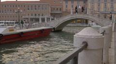 Moored boat near one of the Venetian bridges in Venice - stock footage