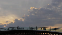 Beautiful view of people on Ponte della Costituzione and sky at sunset in Venice Stock Footage