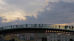 People on Ponte della Costituzione, buildings and sky at sunset in Venice Stock Footage