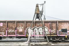 Stock Photo of Graffiti on old freight train at port