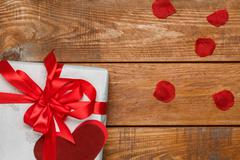 Valentines Day gift and hearts  on wooden background - stock photo