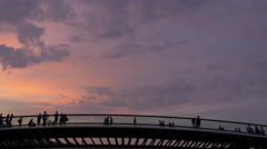 Amazing view of people on Ponte della Costituzione at sunset in Venice Stock Footage