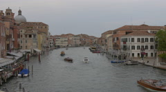 Moored boats and boats navigating on Grand Canal in Venice - stock footage