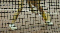 Tennis net & girl tennis player in the background, Full HD Stock Footage