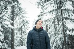 Happy man in winter season with tree on the back Stock Photos