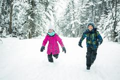 Little girl and boy in winter season - stock photo