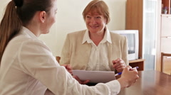 Mature woman talking with employee Stock Footage