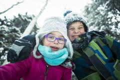 Stock Photo of Little girl and boy in winter season