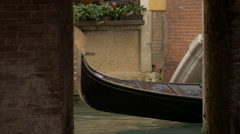 Two gondolas with tourists navigating seen from a window in Venice - stock footage