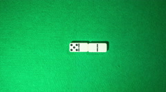 Stop motion of domino game on green cloth background. Spiral form. Stock Footage