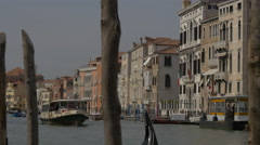 View of a boat navigating on one of the canals in Venice - stock footage