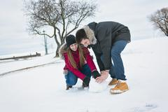 Two teenagers havinf fun on the snow field Stock Photos