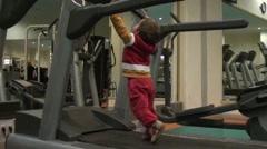 Child walks on running track - stock footage