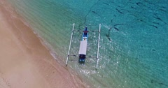 Traditional fishing boat on Jimberan beach in Bali, Indonesia Stock Footage